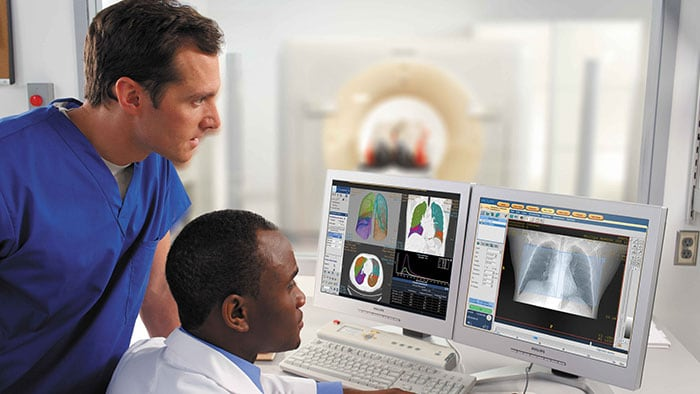 Clinicians analyzing hi resolution radiology scan images - Advanced radiology