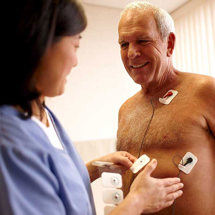 Doctor applying test pads
