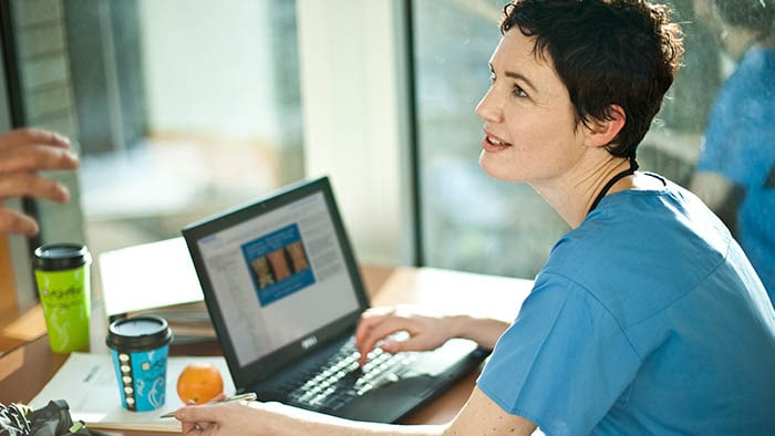 Nurse studying on online learning center