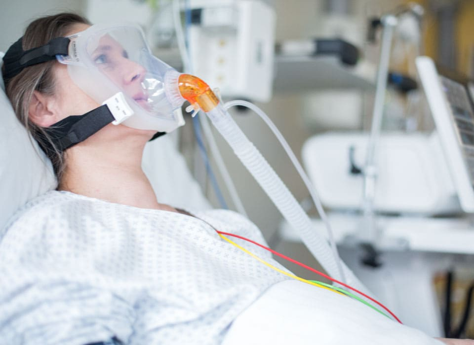 patient with a noninvasive ventilation interface