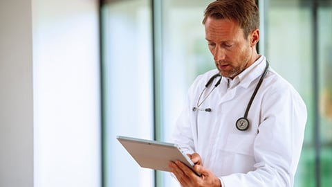 Physician looking at tablet