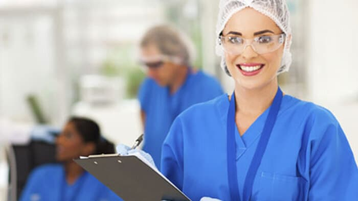 Clinical trials doctor in medical clothing holding clipboard