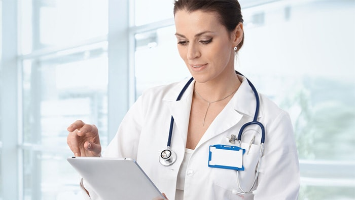 Resource doctor reading clinical research study