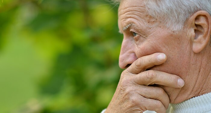 Older man having trouble breathing