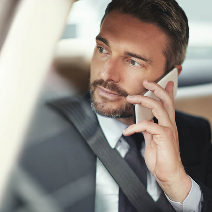 Man in car on phone