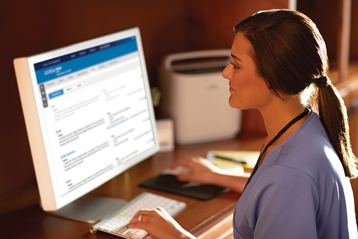 A respiratory therapist views oxygen patient data through Care Orchestrator, Philips remote patient management system